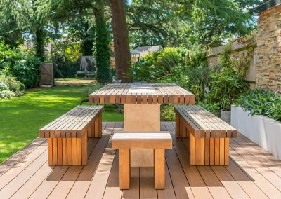 Wooden patio furniture designed by Ben Rousseau