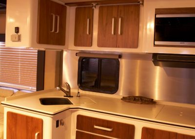 kitchen in Gulfstream tour bus with interior designed by Ben Rousseau